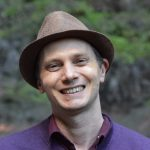 Gareth Vanderhope Children's Author Wearing a Brown Trilby Hat