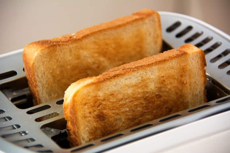 White toast popped up in toaster